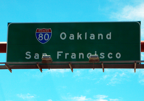 Road sign for Okland and San Francisco